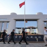 الصين تسجن رئيسا سابقا لمجموعة صحفية بتهمة الاحتيال