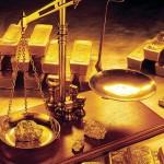 الذهب يتراجع بعد خفض توقعات رفع الفائدة الأمريكية