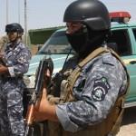 محتجون عراقيون يشتبكون مع الشرطة في كربلاء