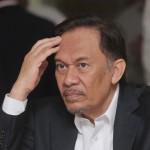 زعيم معارضة ماليزي محبوس يحث الناخبين على انتخاب مهاتير محمد