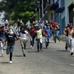 مواجهات في كراكاس بين الشرطة والمعارضة