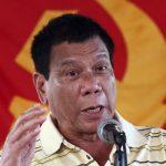 رئيس الفلبين المنتخب يعتذر عن قطع رأس رهينة كندي