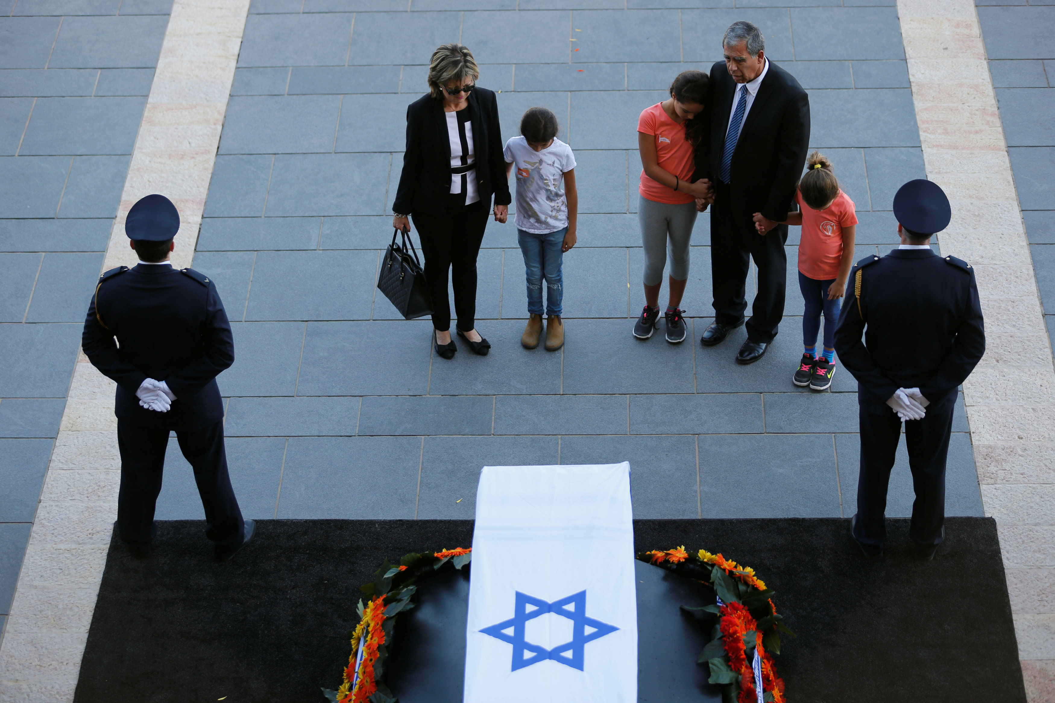 Former Israeli member of parliament Micky Levy in front of the flag-draped coffin of former Israeli President Shimon Peres, as he lies in state at the Knesset plaza, the Israeli parliament, in Jerusalem