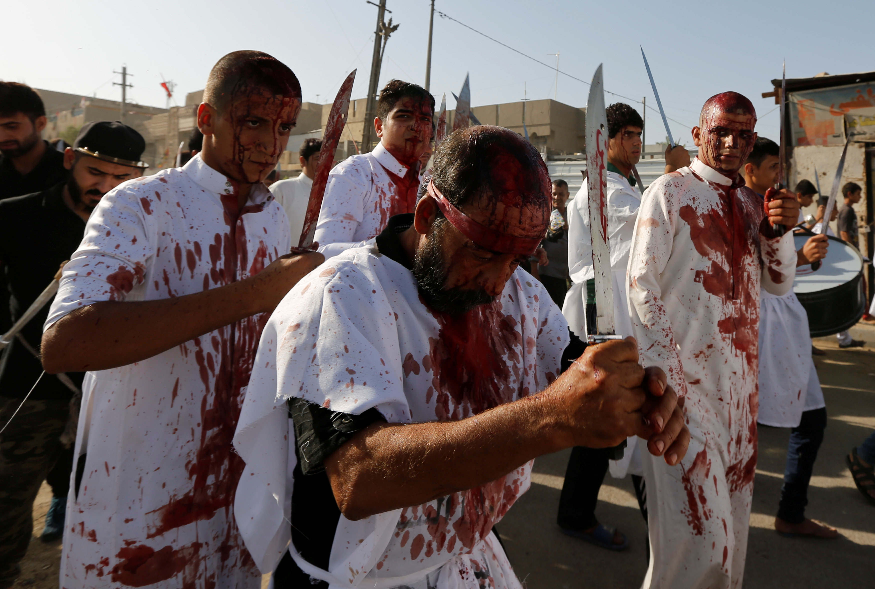 Iraq Shi'ite Muslim men bleed as they gash their foreheads with swords and beat themselves while commemorating Ashura in Baghdad
