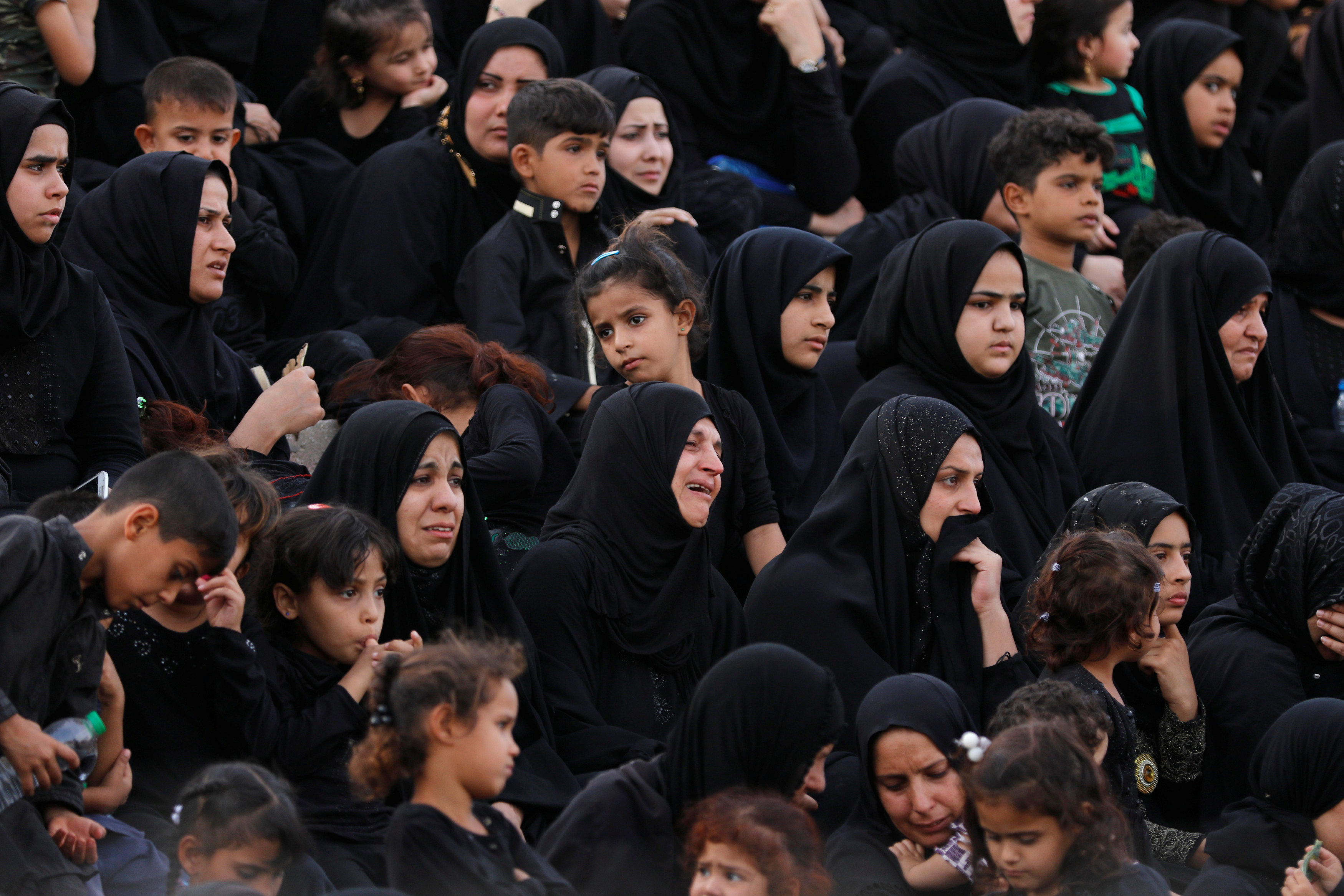 Shi'ite women cry as they watch a re-enactment of the 7th century battle of Kerbala during commemoration in Sadr City, Baghdad