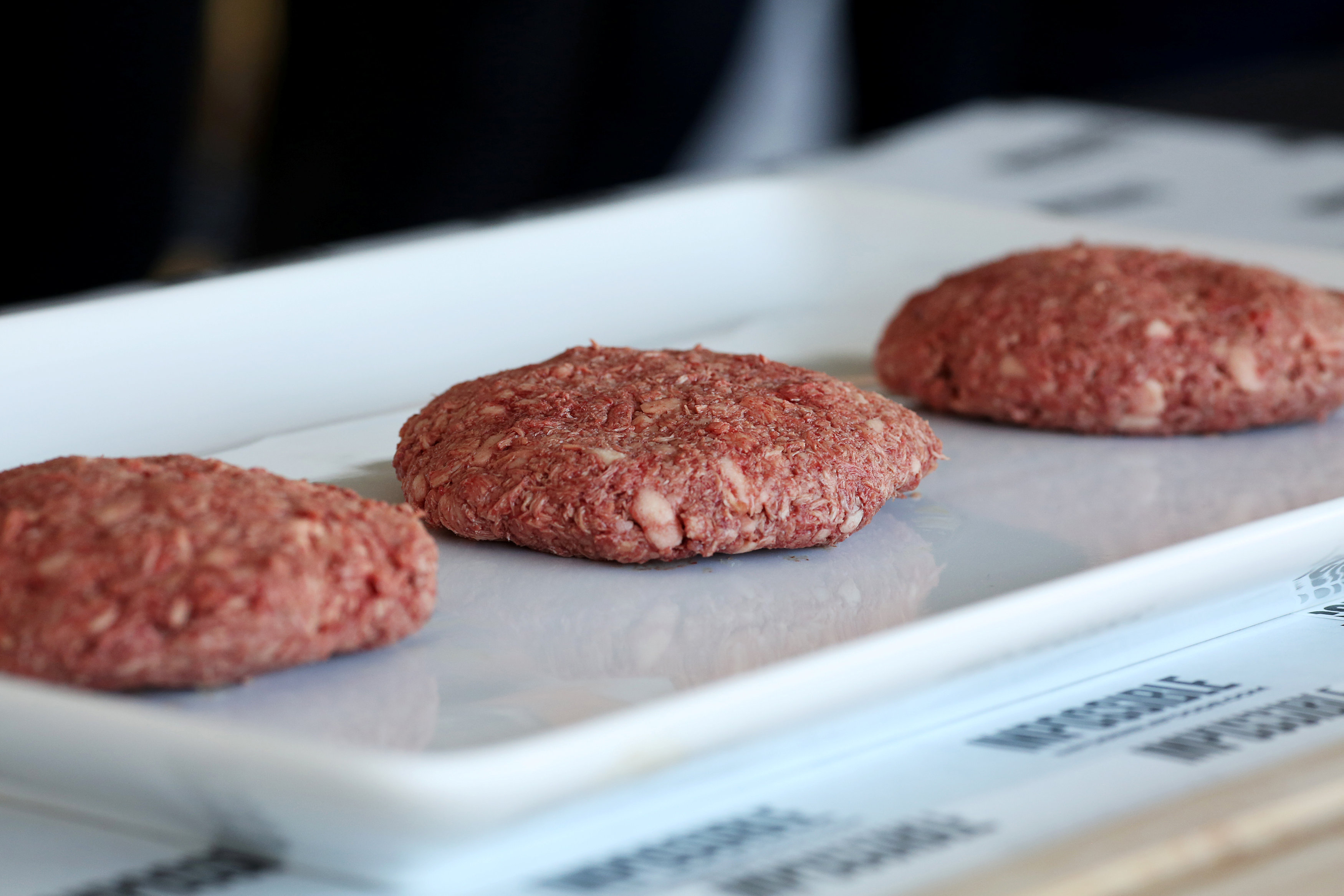Plant-based hamburger patties are on display during a media tour of Impossible Foods labs and processing plant in Redwood City, California, U.S. October 6, 2016. Picture taken October 6, 2016. REUTERS/Beck Diefenbach