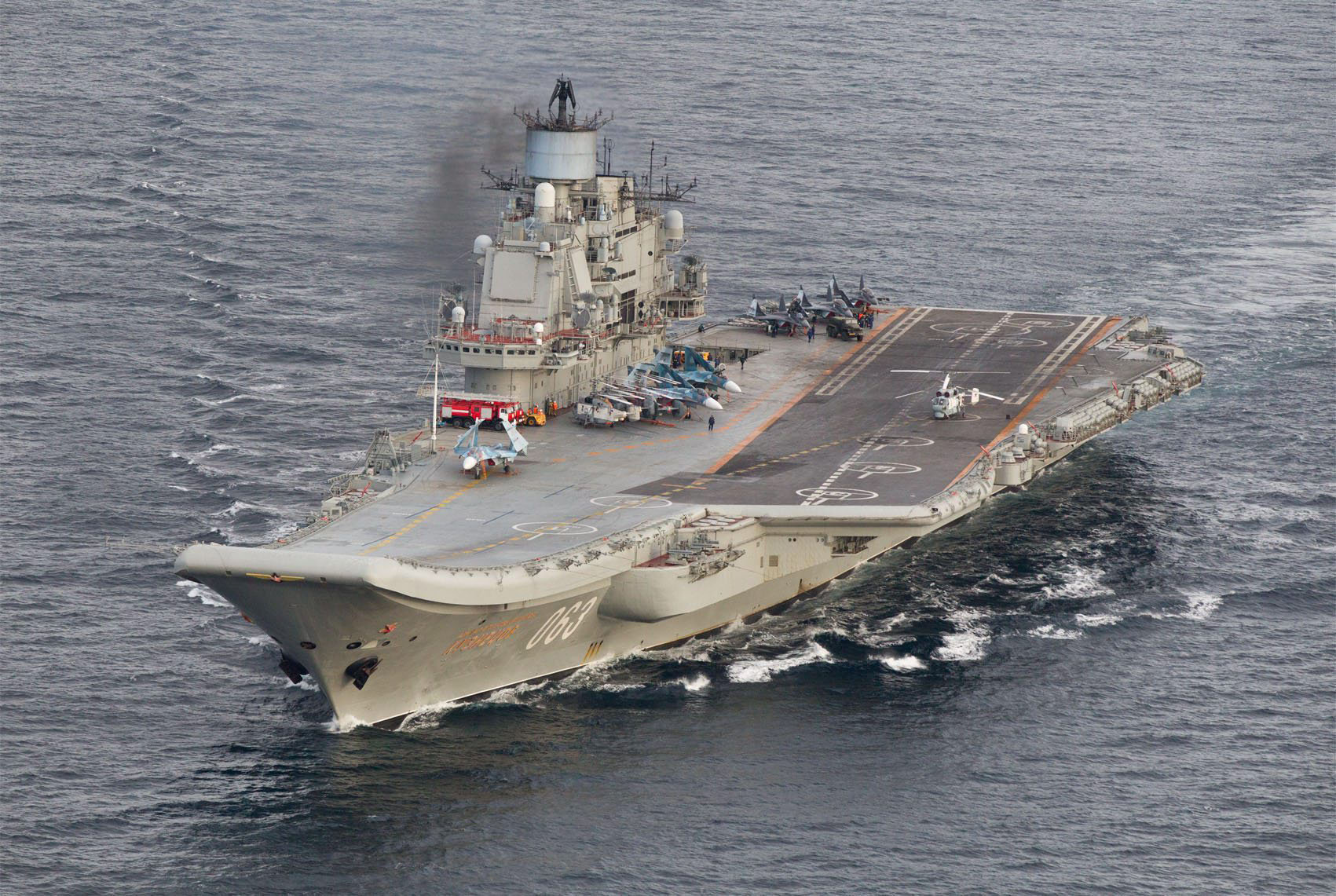 A photo taken from a Norwegian surveillance aircraft shows Russian aircraft carrier Admiral Kuznetsov in international waters off the coast of Northern Norway