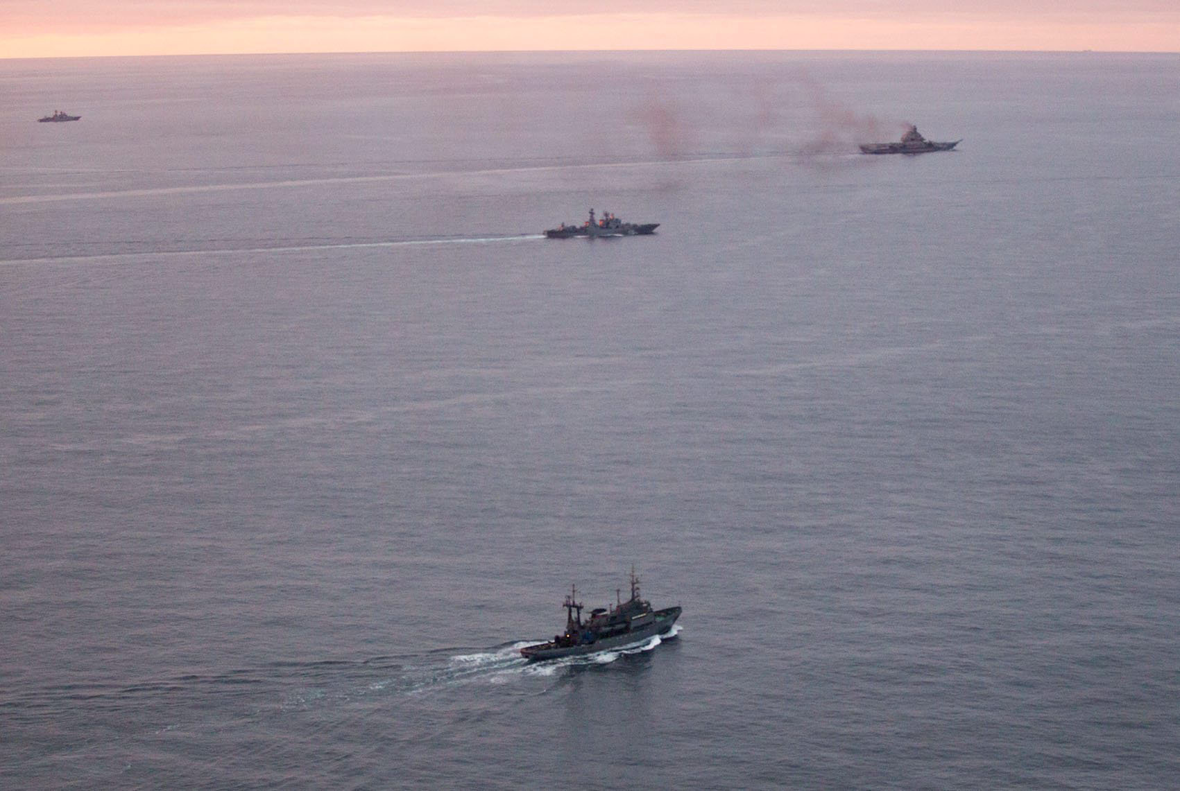 A photo taken from a Norwegian surveillance aircraft shows a group of Russian navy ships in international waters off the coast of Northern Norway