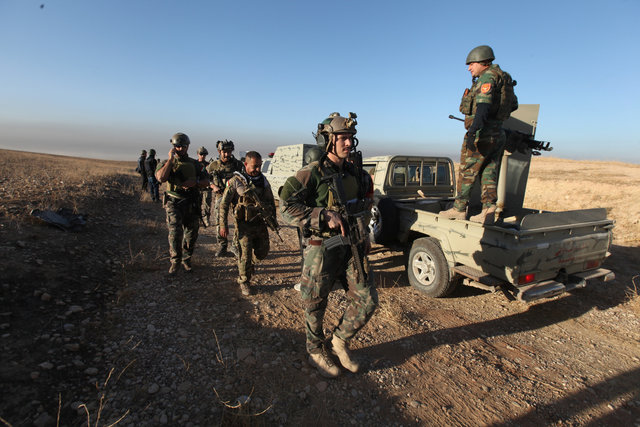 Peshmerga forces with western forces advance in the east of Mosul to attack Islamic State militants in Mosul, Iraq, October 17, 2016. REUTERS/Azad Lashkari