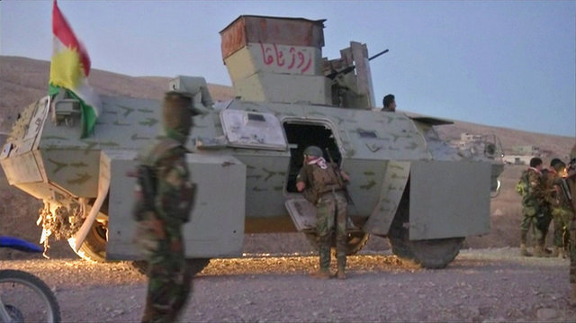A soldier looks inside a armoured personnel carrier in Khazer, west of Erbil, Iraq in this still frame taken from video October 17, 2016. REUTERS/Reuters TV