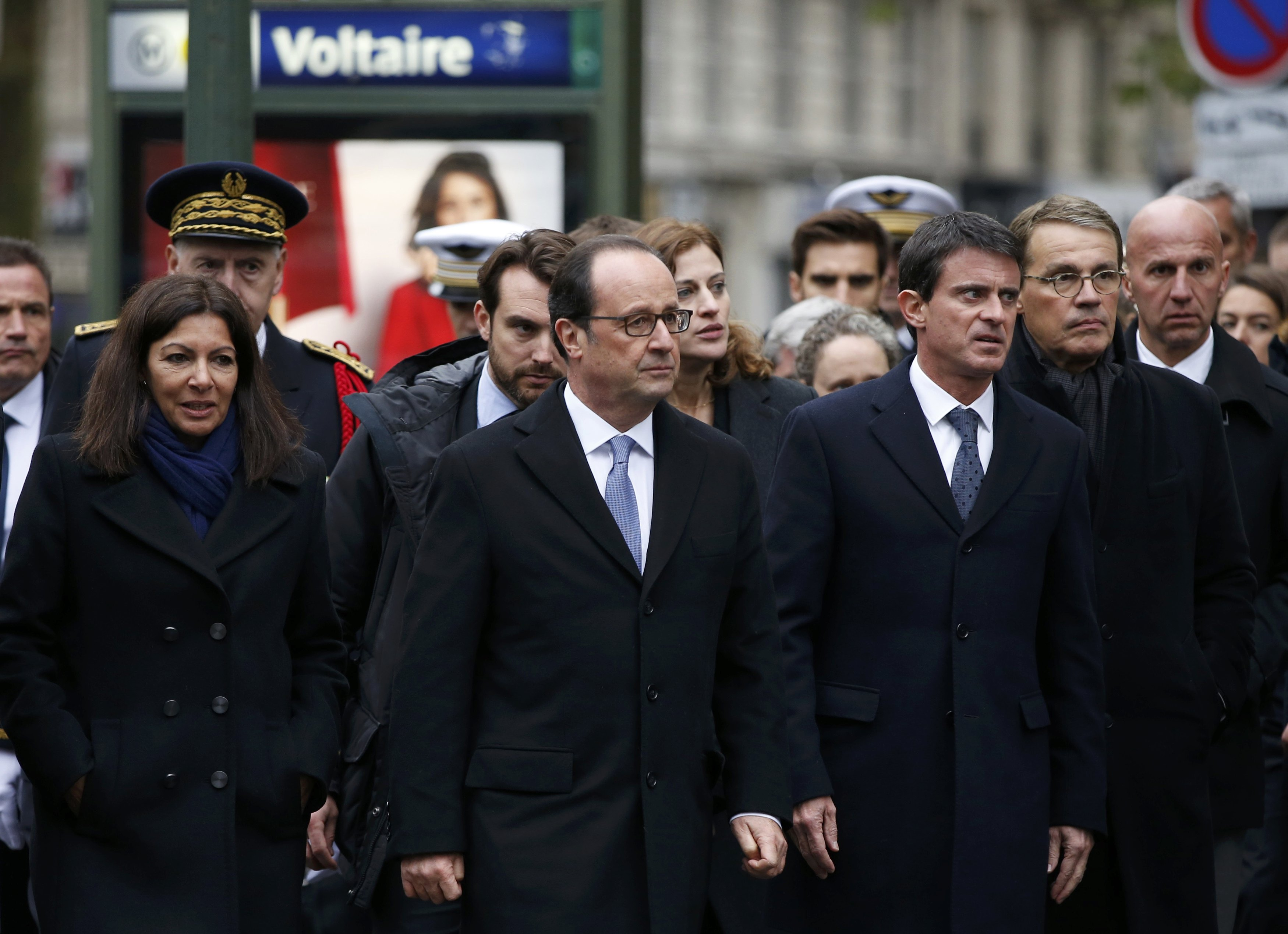 Officials including French President Hollande, Prime Minister Valls and Paris Mayor Hidalgo arrive at Paris 11th district town hall