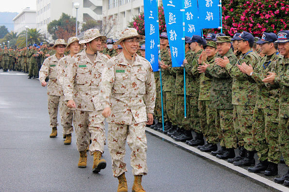 KAITA, JAPAN - DECEMBER 16: (CHINA OUT, SOUTH KOREA OUT) Members of an advance group of the Japan Ground Self-Defense Force are seen off at the JGSDF Kaita base on December 16, 2014 in Kaita, Hiroshima, Japan. The 65-member team will be deployed in Djibouti for an anti-piracy operation off Somalia. (Photo by The Asahi Shimbun via Getty Images)