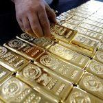 الذهب يوسع مكاسبه مع ضعف الدولار بعد إحجام المركزي الأمريكي عن رفع الفائدة