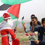 صور| الاحتلال يطلق الرصاص على بابا نويل الفلسطيني