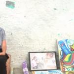 فيديو| كريمة.. فنانة مغربية تتحدى إعاقتها وترسم لوحات بقدمها