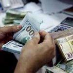 الدينار الليبي يقفز بقوة أمام الدولار في السوق السوداء