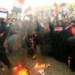 حرق العلم الأمريكي خلال تظاهرة في بغداد احتجاجا على قصف سوريا