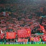 توجيه الاتهام لرجلين في الاعتداء على أحد مشجعي ليفربول