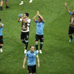 الأوروغواي وروسيا أول المتأهلين إلى ثمن النهائي