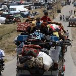 آلاف النازحين يعودون إلى منازلهم بعد اتفاق لوقف القتال في جنوب سوريا
