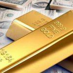 الذهب ينخفض مع ارتفاع الدولار في ظل مخاوف التجارة