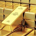 الذهب يستقر قرب ذروة قياسية مع انتعاش الدولار