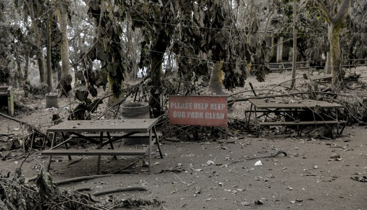 Picnic tables are covered with volcanic ash in a park in Tagaytay City,