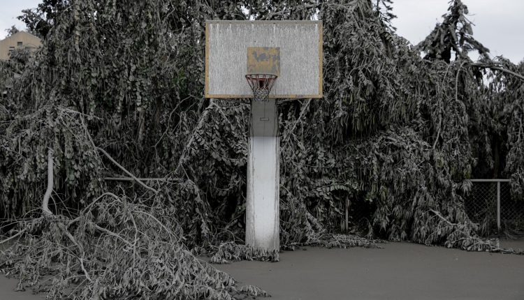 A basketball court is blanketed with volcanic ash in a resort near the errupting Taal Volcano in Talisay