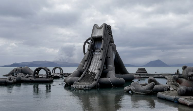Inflatables floating on Taal Lake are covered with volcanic ash in a resort near the errupting Taal Volcano in Talisay