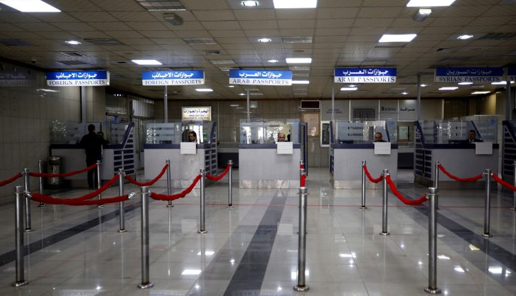 Passport control counters are pictured inside Aleppo international airport