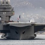 حاملة طائرات فرنسية تعود للميناء للاشتباه بوجود حالات كورونا
