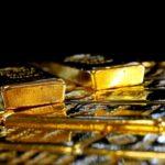 الذهب يهبط مع صعود الدولار لأعلى مستوى في أسبوعين